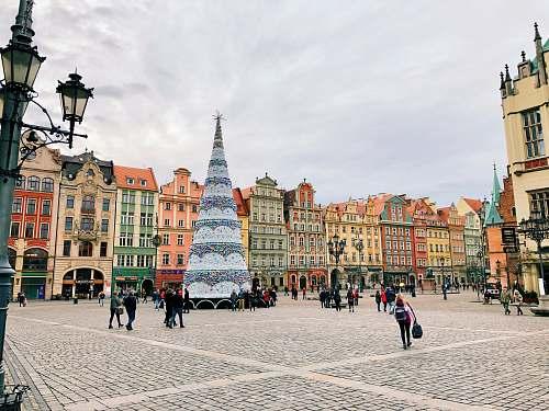 urban people walking beside giant Christmas tree town