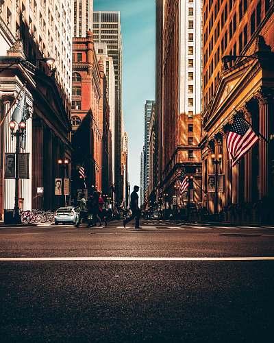 street people walking between concrete buildings building