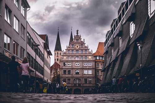 urban people walking near buildings during daytime town