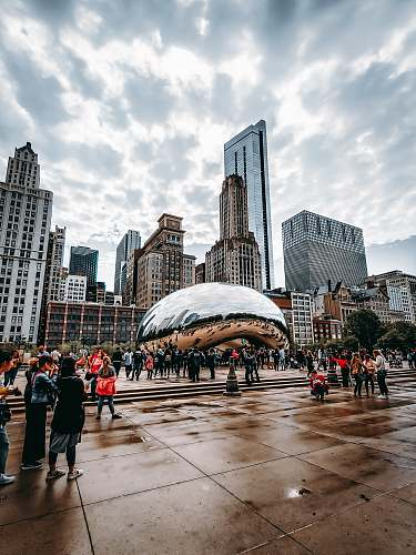 urban people walking near Cloud Gate in Chicago during daytime downtown