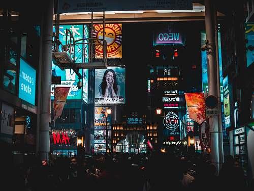 urban people walking on streets at nighttime metropolis