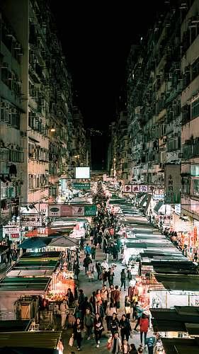 building people walking on the streets between buildings metropolis