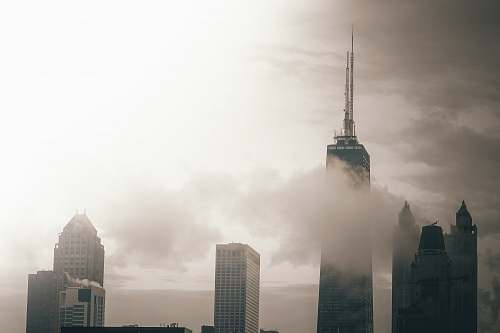 fog photo of building surrounded by clouds architecture
