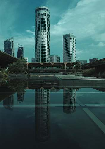 building reflection of high rise buildings on mirror floor town