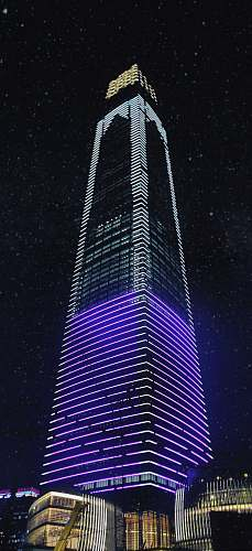 building white and violet lit building high rise