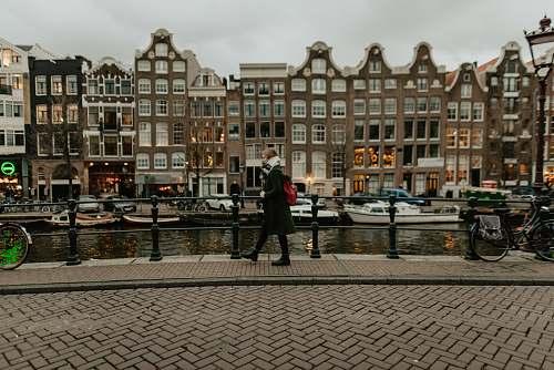 person woman walking beside canal human