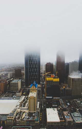 nature aerial photography of buildings under cloudy sky outdoors