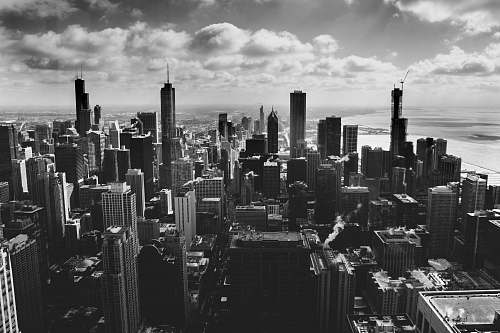 outdoors grayscale photography of high-rise buildigns black-and-white