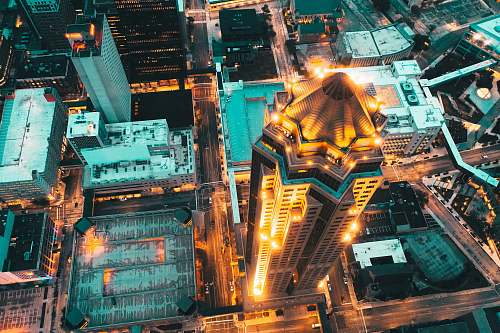 outdoors aerial photography of city with high-rise buildings at night time scenery