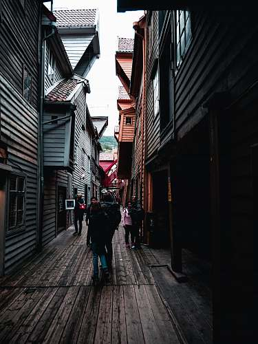 street people walking on narrow pathway during daytime town