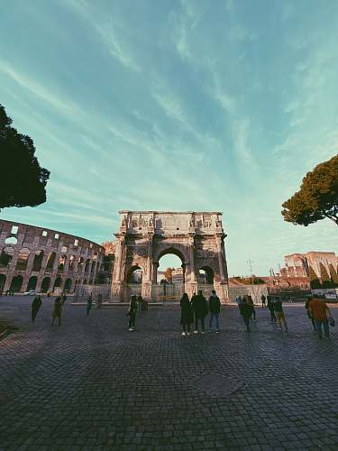 town people standing near The Colosseum building