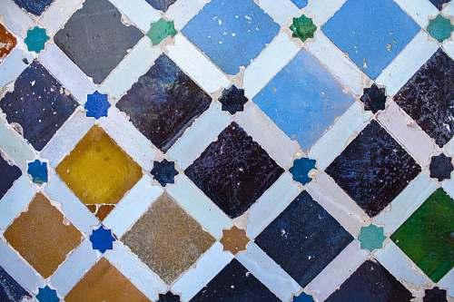 spain teal, purple, and brown tile rug