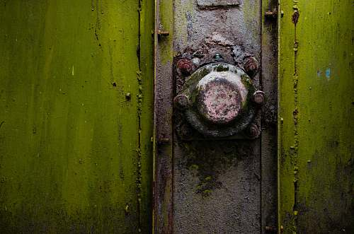 photo rust A close-up of a rusty metal knob on a green strongbox romania free for commercial use images