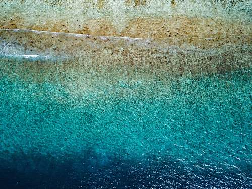 water aerial photography of shore blue