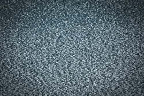 grey blue textile in close up image rug