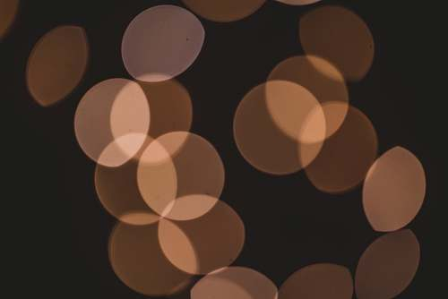 brown bokeh lights face
