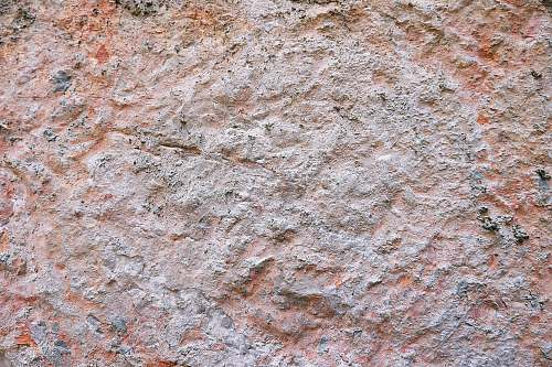 photo rock brown graphite stone surface wall free for commercial use images