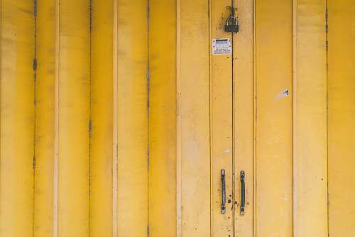 background closed yellow wooden door with padlock yellow