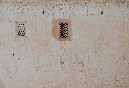 wall photography of closed window amber palace