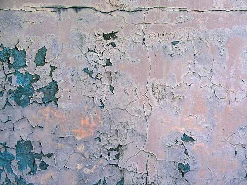 grey wall with cracked surface wall