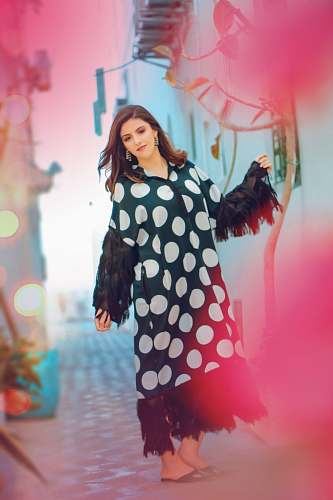 polka dot woman in black and white polka dot long sleeve dress person