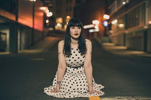 human woman wearing white and black polka-dot dress person