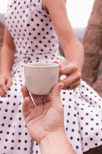 human women;s white polka dot dress close-up photography person