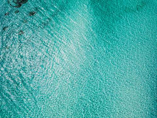 texture aerial view photography of body of water rug