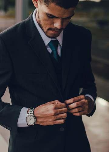 accessory man wearing notched lapel suit jacket tie