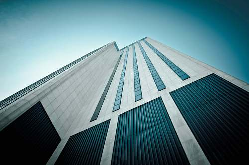 building worm's eyeview of white and black concrete building skyscraper