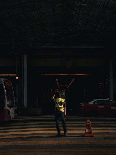 tarmac man standing on road road