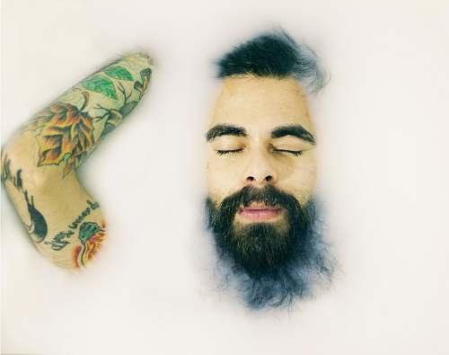 tattoo man closing his eyes man