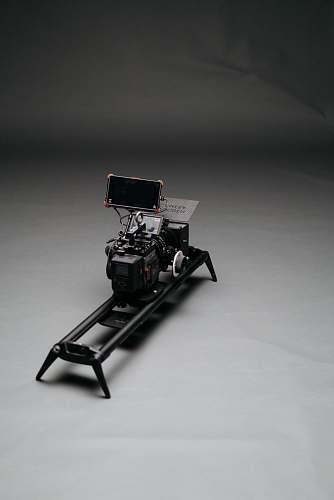 grey black video camera with slider machine