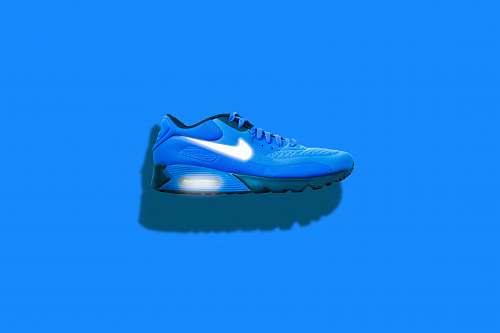 shoe blue, white, and black Nike running shoes clothing