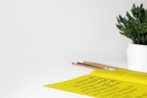text yellow printer paper on table paper