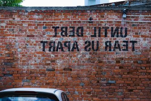 lxmarket until debt tear us apart brick wall vandal lisboa