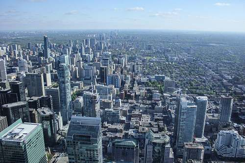 city aerial view photography of city buildings under clear blue sky during daytime skyscraper