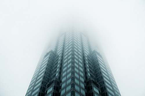 architecture black high-rise building covered with fog skyscraper