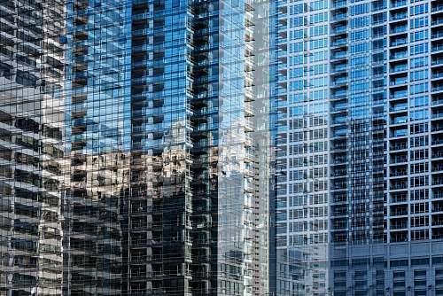 condo blue glass high-rise buildings view housing