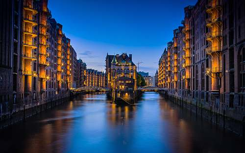 hamburg canal between buildings during nighttime germany