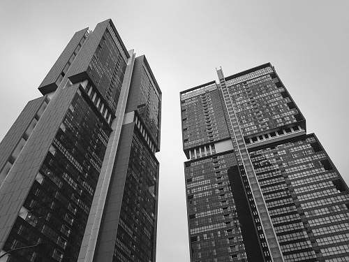 architecture grayscale low-angle photography of concrete building black-and-white