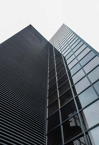 architecture low angle photography of black glass building madrid