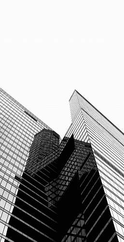 black-and-white low-angle photography of high-rise building architecture