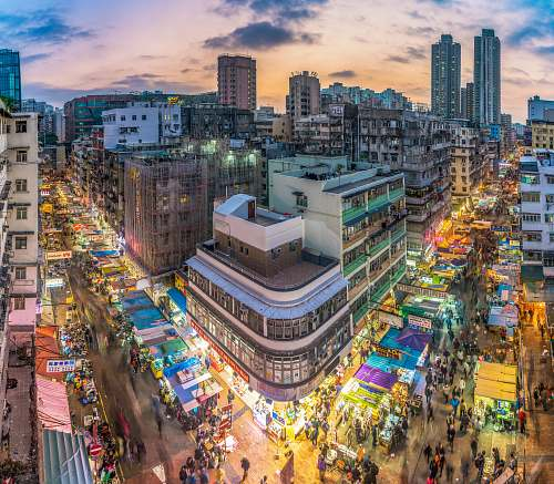 city people walking along city streets cityscape