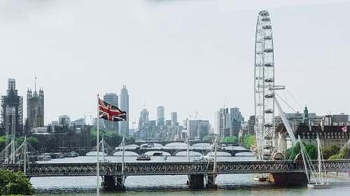 bridge photography of ferris wheel during daytime london