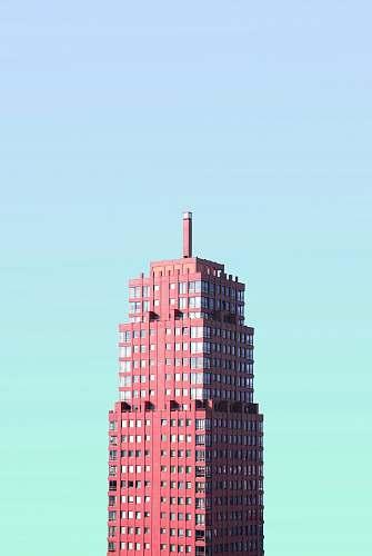 skyscraper red high-rise building under blue sky architecture