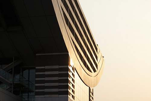 photo architecture The facade and roof of a modern building in bright sunlight structure free for commercial use images