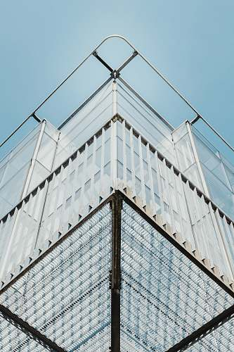 belgium white high-rise building with blue sky louvain-la-neuve