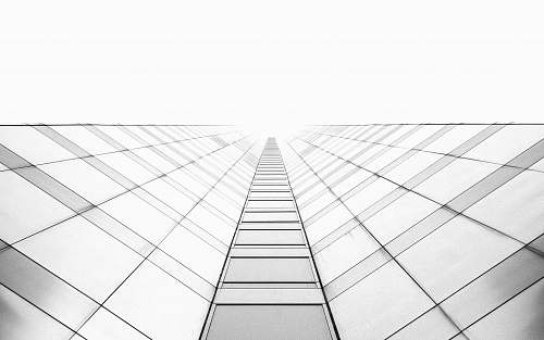 black-and-white worm's eye view photography of high-rise building white