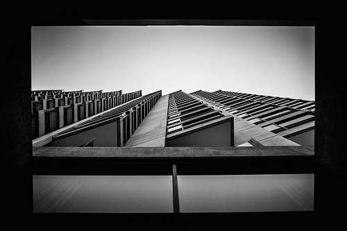 architecture worm's eyeview of multi-storey building black-and-white